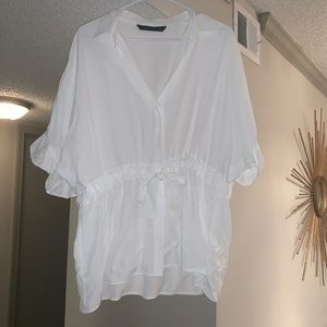 Casual yes classy white shirt with ruffle sides!